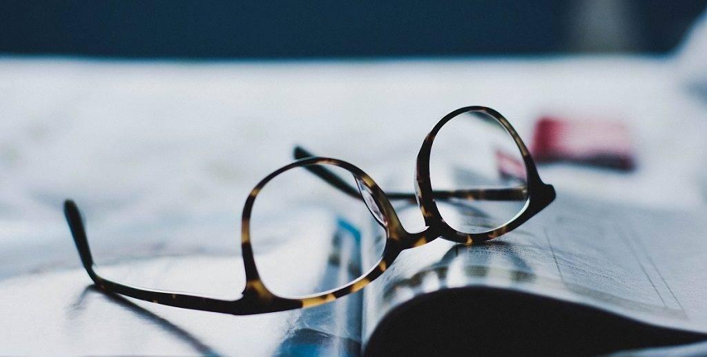 eyeglasses-on-a-book-e1522085075174
