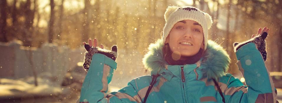 girl-throwing-snow