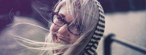 woman long hair glasses nose ring