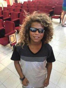 Child in Peru with new sunglasses, donated by volunteer optometrists from Colorado Springs, CO