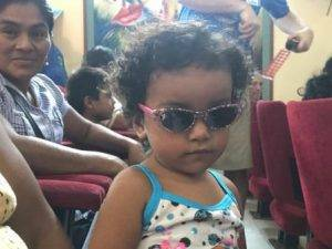 little girl in Peru with new sunglasses, donated by eye care mission from Colorado Springs, CO