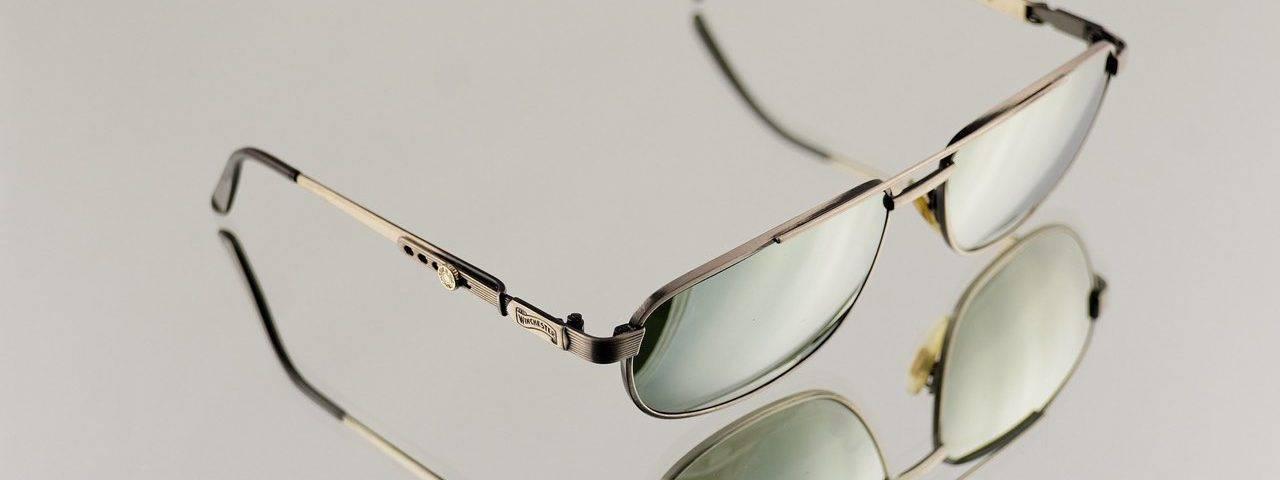 eyeglasses lying on the sand