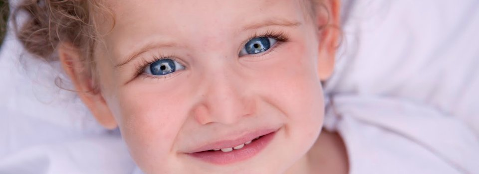 close-up-of-blue-eyed-toddler-slide.png