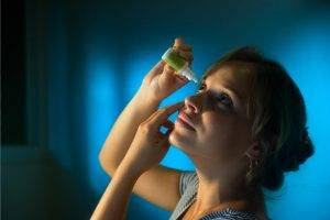 Eye doctor, Woman Putting in Eye Drops in Rockford, Illinois