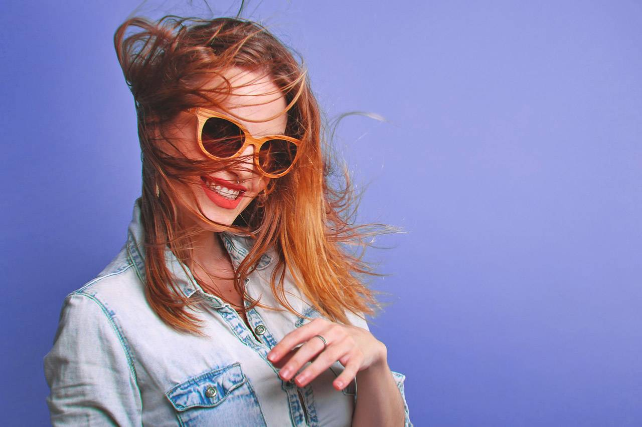 Woman Wearing Sunglasses with Hair Blowing 1280×853