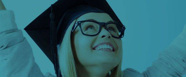 Female graduating smiling with glasses on