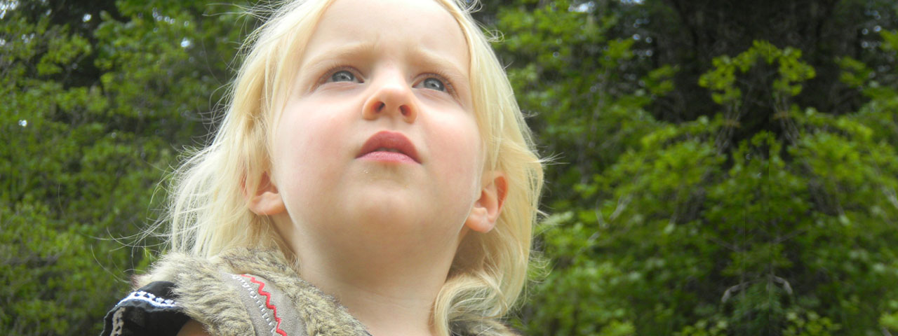 Female-Child-Looking-Upward-1280x480