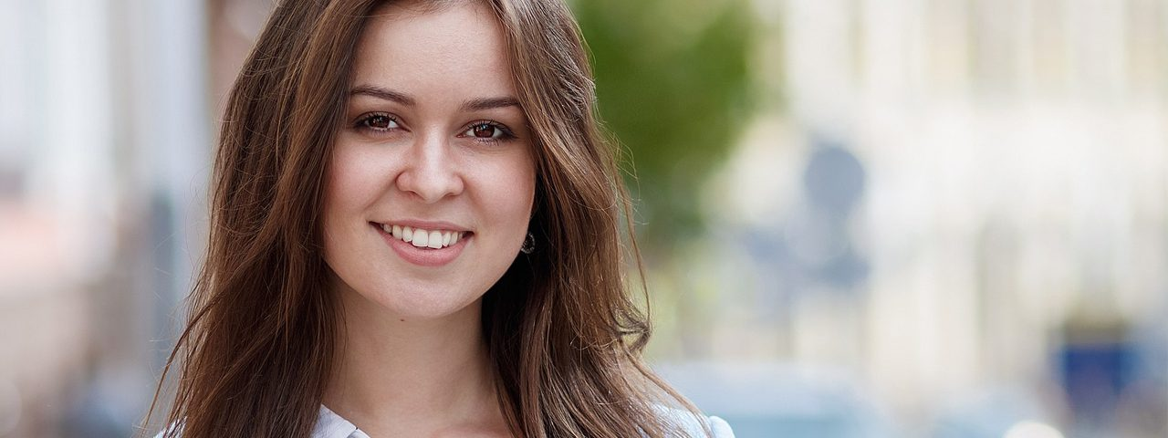 Girl Smiling Brown Hair 1280x480 e1514115318137