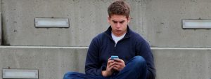Male Teen Texting 1280x480