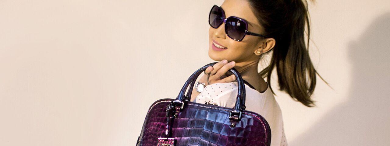 asian woman wearing sunglasses and carrying purple handbag in hilo hi
