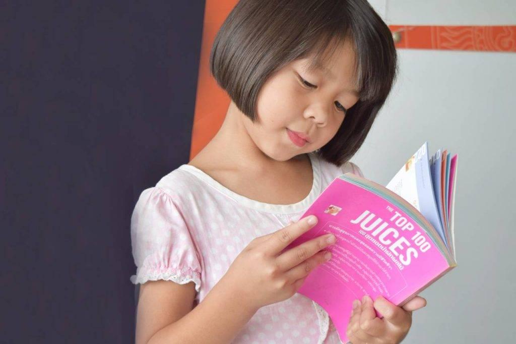 Asian Girl Reading Book in Mississauga, Ontario