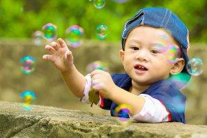 Baby boy playing with bubbles | Pediatric Eye Exams In Warminster PA