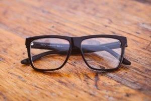 Eye doctor, pair of glasses on wood in Kissimmee & Lakeland, FL