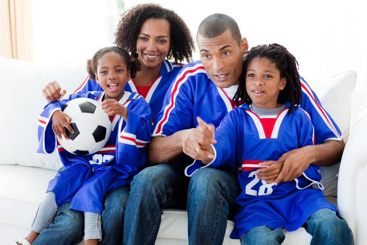 Happy Family Watching Sports 1280x853