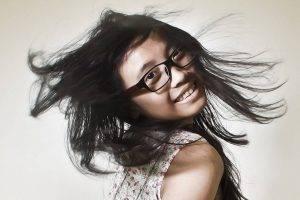 Happy Girl Flippig Hair Glasses 1280x853 300x200