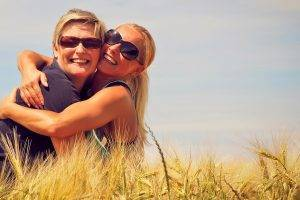 Hugging Wearing Sunglasses