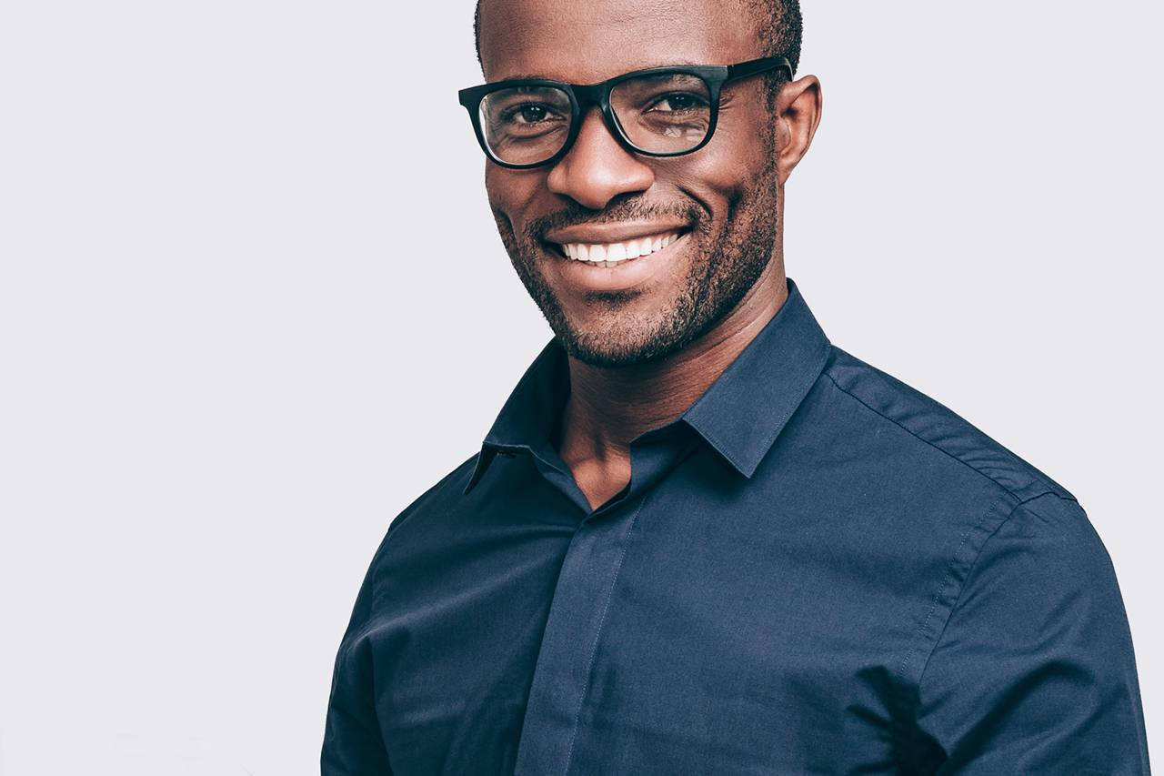 Man-Smiling-Black-Glasses-1280x853