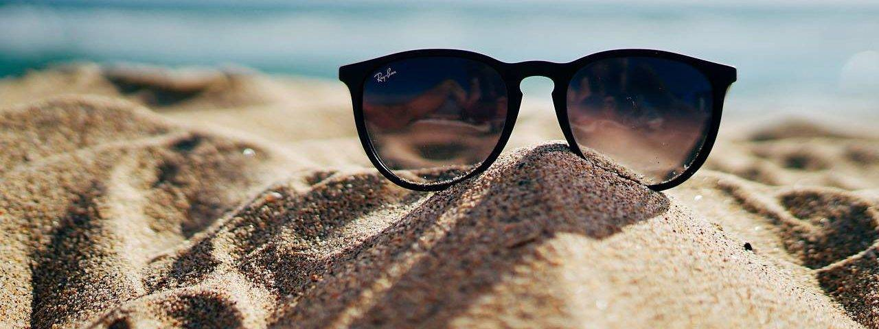 Sunglasses-Beach-Sand-Pile-1280x853-1280x480