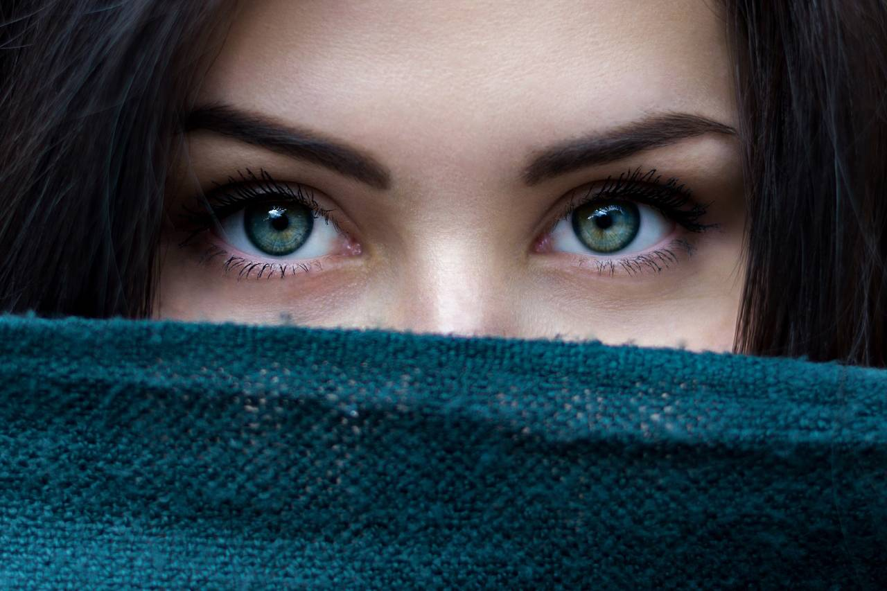 close up of woman's green eyes to advertise contact lenses