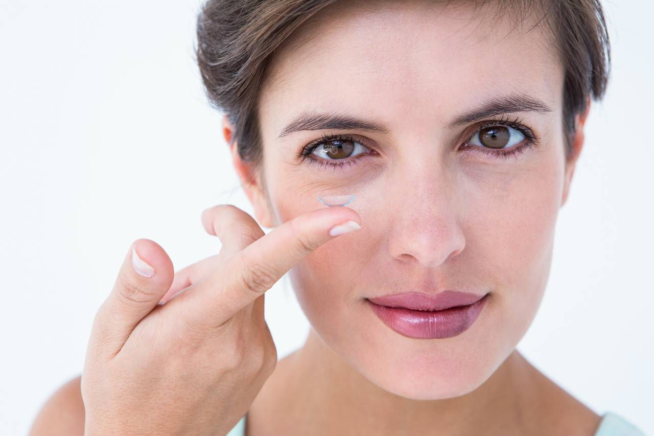 Woman Holding Contact Lens 1280x853
