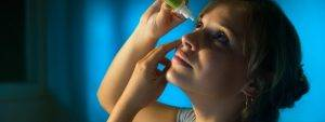 Woman Putting in Eye Drops in Bardstown, KY