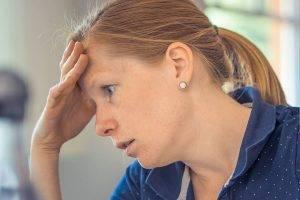 Woman Resting Head on Hand 1280x853