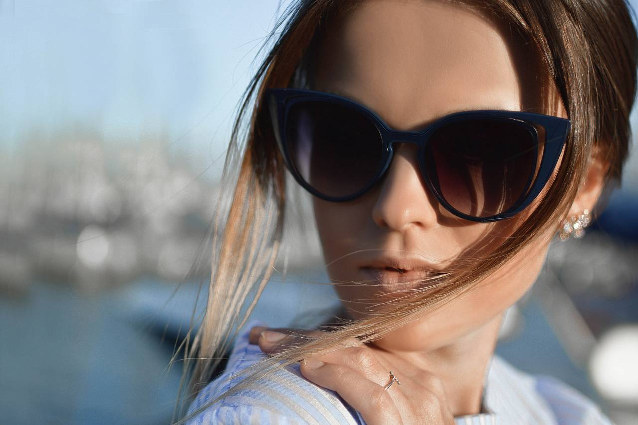 Woman-Sunglasses-Hair-Blowing-1280x853