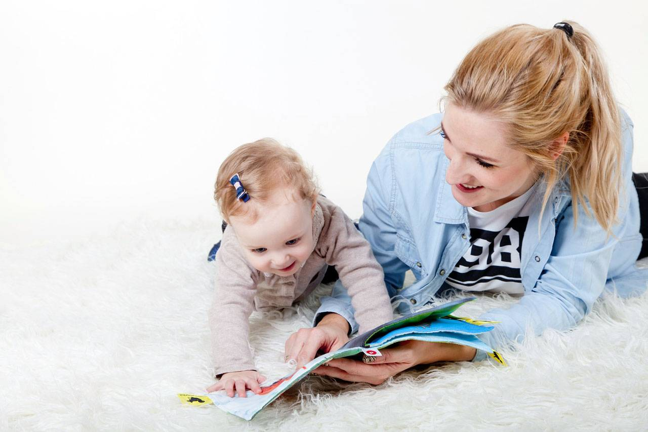 Young Mother Reading to Baby 1280x853
