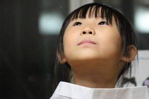 asian girl looks up