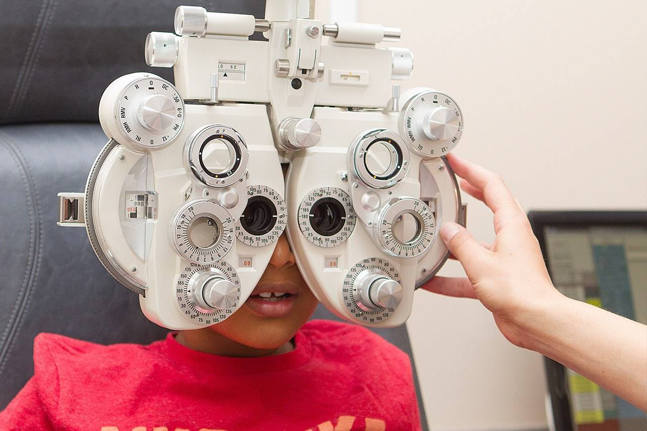 Little girl getting her eyes tested
