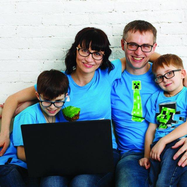 Family wearing eyeglasses and looking at computer in Dartmouth