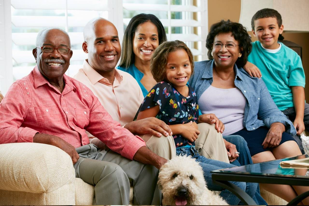 happy African American family with their dog
