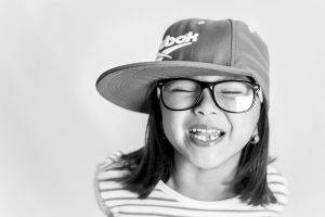 Eye doctor, happy asian girl wearing glasses in North Miami Beach, FL
