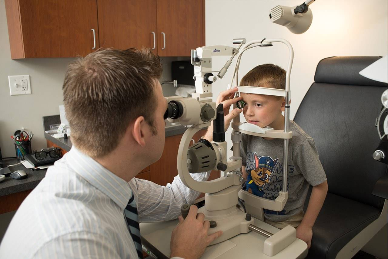 little boy getting eyes checkd