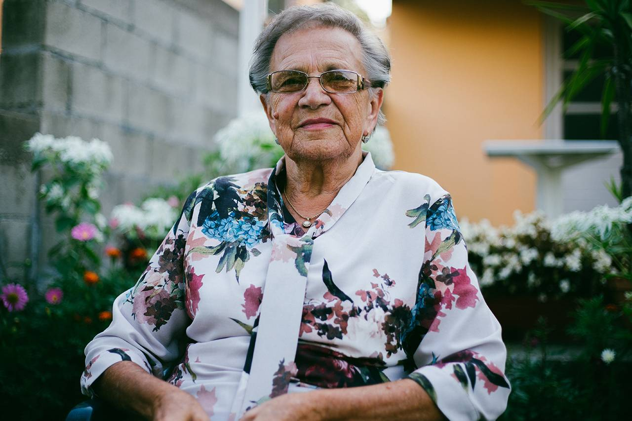 elder woman sitting with glasses