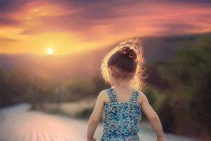 little girl walking during sunset