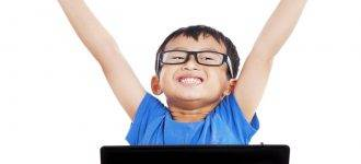 excited asian boy wearing glasses