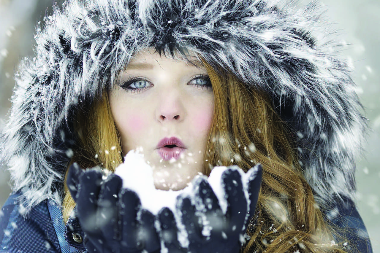 winter bgs girl blows snow