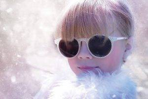 girl wearing sunglasses in the snow