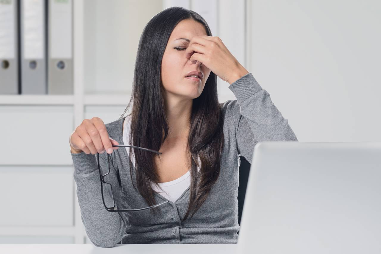 woman suffering eye strain