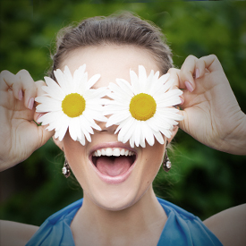 woman with sunflowers over her eyes