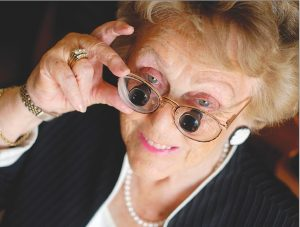 Eye doctor, senior woman wearing low vision glasses in Chula Vista, CA