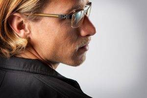 blonde man wearing lenscrafters eyeglasses