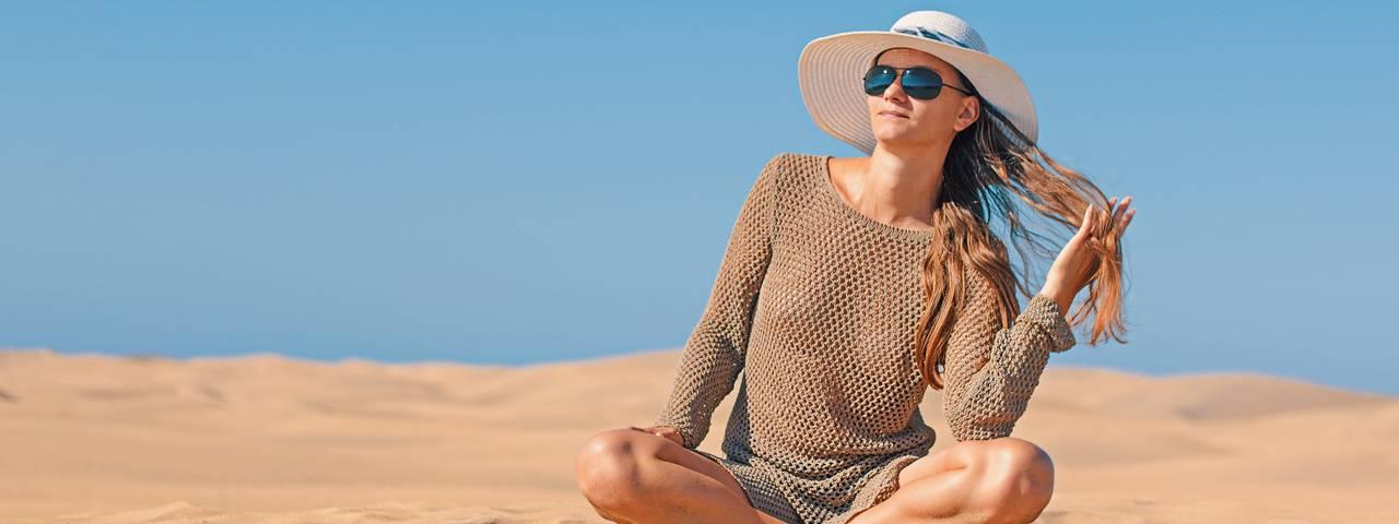 blonde woman wearing sunglasses on the beach