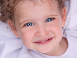 close up of blue eyed toddler