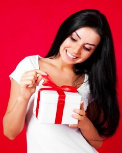 woman with red and white present