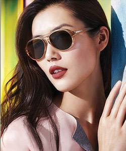 Model wearing Ray Ban sunglasses