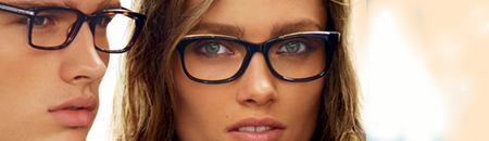 advertisement for Michael Kors eyeglasses with attractive male and female models