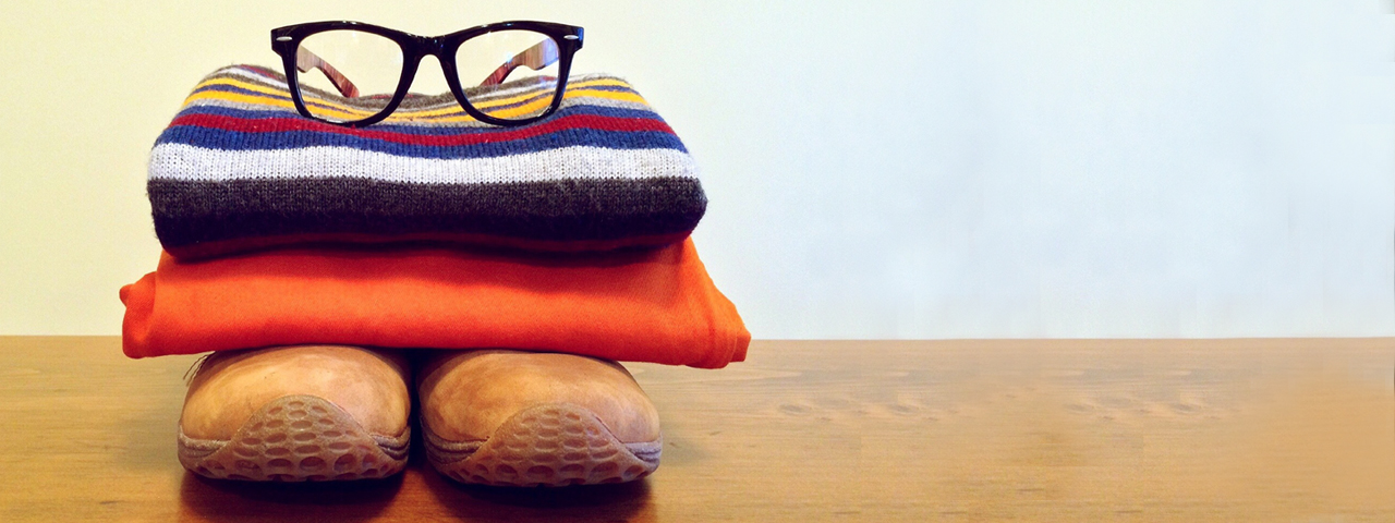 Clothing-Pile-Wearing-Glasses1280x480