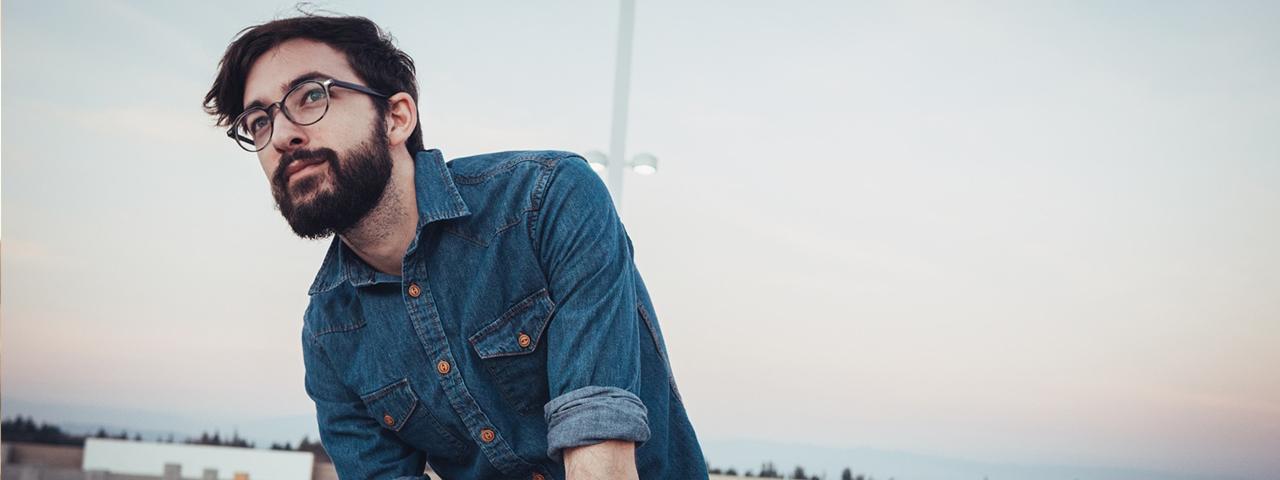 Dark Hair Blue Shirt Man Glasses 1280x480